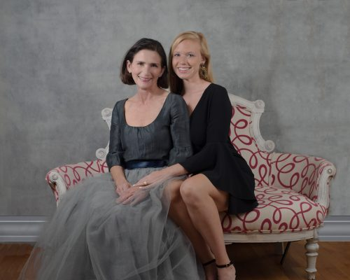 mother daughter photoshoot on a favorite sofa.