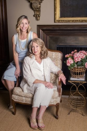 elegant mother daughter photo shoot in front of fireplace.